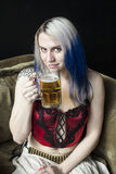 Beautiful Young Woman with Blue Hair Drinking Beer Stock Photos