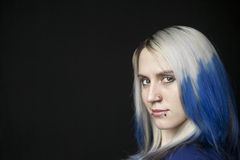 Beautiful Young Woman with Blue Hair on Black Background Stock Photo