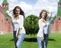 Portrait of a beautiful young woman in a blue jeans shirt on the Royalty Free Stock Image