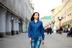 Portrait of a beautiful young woman in a blue jeans shirt on th stock photo