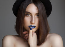 Portrait of beautiful young woman with blue lips and in hat. Bea Royalty Free Stock Photo