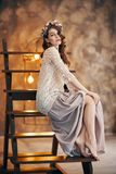 Portrait of beautiful young woman in boho style dress stock photo