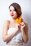 Portrait of beautiful young woman with bottle of perfume on the Royalty Free Stock Image