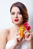 Portrait of beautiful young woman with bottle of perfume on the Stock Photography