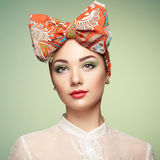 Portrait of beautiful young woman with bow Stock Images