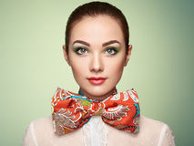 Portrait of beautiful young woman with bow Royalty Free Stock Photography