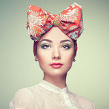 Portrait of beautiful young woman with bow Stock Photos