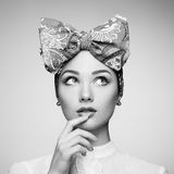 Portrait of beautiful young woman with bow Royalty Free Stock Images