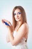 Portrait of a beautiful young woman with bright blue make up Royalty Free Stock Images