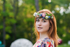 Portrait of a beautiful young woman in a bright dress on a head a wreath of flowers, lifestyle, youth Stock Images