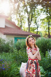Portrait of a beautiful young woman in a bright dress on a head a wreath of flowers, lifestyle, youth Stock Image
