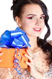 Portrait of a beautiful young woman with a bright gift Stock Photography