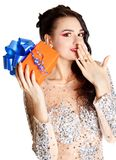 Portrait of a beautiful young woman with a bright gift Stock Photos
