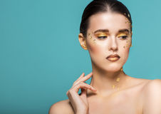 Portrait of a beautiful young woman with bright golden make up Royalty Free Stock Photo