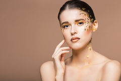 Portrait of a beautiful young woman with bright golden make up Royalty Free Stock Image