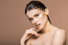 Portrait of a beautiful young woman with bright golden make up Royalty Free Stock Photography