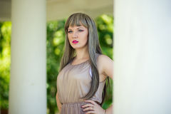 Portrait of a beautiful young woman. With bright make-up wearing a wig with long hair Stock Photos