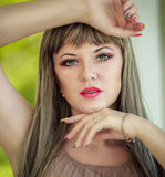 Portrait of a beautiful young woman. With bright make-up wearing a wig with long hair Royalty Free Stock Photography