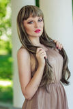 Portrait of a beautiful young woman. With bright make-up wearing a wig with long hair Stock Image