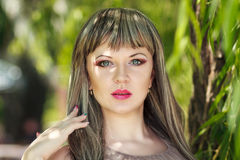 Portrait of a beautiful young woman. With bright make-up wearing a wig with long hair Royalty Free Stock Photo