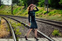 Portrait of beautiful young woman walking on a railway stock photo
