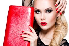 Portrait of beautiful woman with red lips and nails. stock photography
