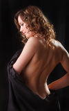 Portrait beautiful young woman with brown long ringlets hair a. Nd naked back and shoulder Royalty Free Stock Image
