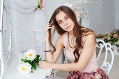 Portrait of a beautiful young woman with a bunch of flowers Stock Photo