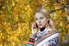 Portrait of a beautiful young woman calling by phone Stock Photos