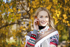 Portrait of a beautiful young woman calling by phone Stock Image