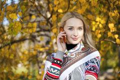 Portrait of a beautiful young woman calling by phone Royalty Free Stock Photos