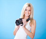 Portrait of beautiful young woman with camera Royalty Free Stock Photos
