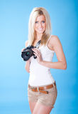 Portrait of beautiful young woman with camera Stock Photo