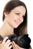 Portrait of a beautiful young woman with camera Stock Photo