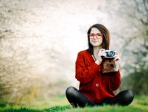 Portrait of young woman with camera royalty free stock photo