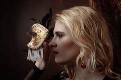 Portrait of beautiful woman with carnival mask. Royalty Free Stock Images