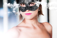 Portrait of beautiful young woman with carnival mask . Fashion and Fantasy Royalty Free Stock Images