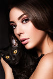 Portrait of the beautiful young woman with cat Royalty Free Stock Image