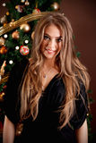Portrait of a beautiful young woman. At Christmas night Royalty Free Stock Photos