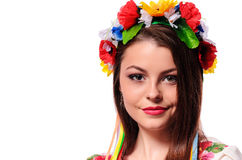 Portrait of beautiful young woman with Christmas wreath. Royalty Free Stock Photos