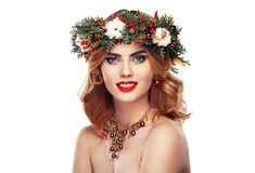 Portrait of beautiful young woman with Christmas wreath Royalty Free Stock Photos
