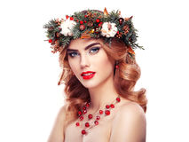 Portrait of beautiful young woman with Christmas wreath Stock Images