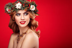 Portrait of beautiful young woman with Christmas wreath Royalty Free Stock Images