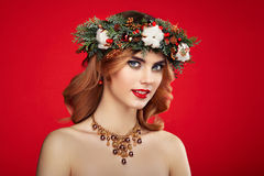Portrait of beautiful young woman with Christmas wreath Stock Photography