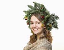 Portrait of beautiful young woman with Christmas wreath on a whi Stock Image
