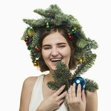 Portrait of beautiful young woman with Christmas wreath. Beautif. Portrait of beautiful young woman with Christmas wreath on a white baskground Stock Photos