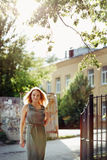 Portrait of beautiful young woman in the city. Summer, freedom. Royalty Free Stock Photography