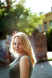 Portrait of beautiful young woman in the city. Summer, freedom. Royalty Free Stock Image