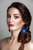 Portrait of beautiful young woman with clean face and french braid Royalty Free Stock Images