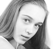 Portrait of beautiful young woman close up. Black and white portrait of beautiful young woman, over white stock image